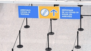 Travellers are directed to take a mandatory COVID-19 test after arriving on a international flight at Pearson International Airport during the COVID-19 pandemic in Toronto on Monday, February 1, 2021. THE CANADIAN PRESS/Nathan Denette