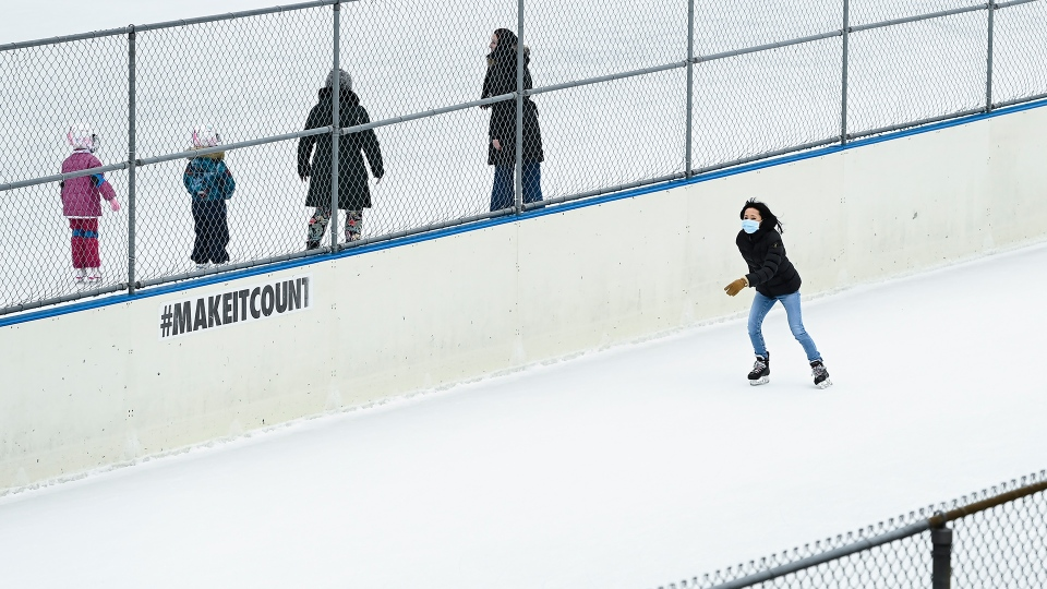 People exercise at an outdoor skating rink during the COVID-19 pandemic in Toronto on Thursday, January 14, 2021. The province of Ontario is currently under an emergency order lockdown. THE CANADIAN PRESS/Nathan Denette