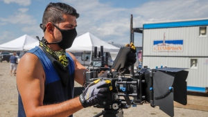 Director Raoul Bhatt films a scene on the set of Pipe Nation in Sundre, Alta., Monday, Aug. 17, 2020. Pipe Nation is a gritty television drama about a debt-ridden, single mom working in the oilpatch. THE CANADIAN PRESS/Jeff McIntosh