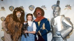 "Costumed ""Wizard of Oz"" characters attend the ""Wizard of Oz"" 70th Anniversary Emerald Gala on Sept. 24, 2009, in New York. New Line Cinema is making a new adaptation of ""The Wonderful Wizard of Oz,"" the L. Frank Baum children's novel, with Nicole Kassell, the visual architect of ""Watchmen,"" set to direct. (AP Photo/Charles Sykes, File)"