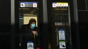 An elderly man wears a protective mask on the street car during the COVID-19 pandemic in Toronto on Wednesday, February 10, 2021. THE CANADIAN PRESS/Nathan Denette