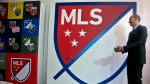 Major League Soccer Commissioner Don Garber launch the league's new logo during a press conference Thursday, Sept. 18, 2014, in New York. THE CANADIAN PRESS/AP, Bebeto Matthews