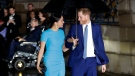 FILE - Britain's Prince Harry and Meghan arrive at the annual Endeavour Fund Awards in London, Thursday, March 5, 2020. The Duke and Duchess of Sussex are expecting their second child, their office confirmed Sunday, Feb. 14, 2021. (AP Photo/Kirsty Wigglesworth, file)