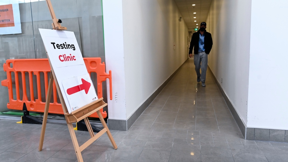 A man leaves a COVID-19 assessment centre at the Wellfort Community Health Services facility in Mississauga, Ont., on Tuesday, February 9, 2021. THE CANADIAN PRESS/Nathan Denette