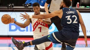 Toronto Raptors' Kyle Lowry(7) tries to pass against Minnesota Timberwolves' Karl-Anthony Towns (32) during the second half of an NBA basketball game Sunday, Feb. 14, 2021, in Tampa, Fla. (AP Photo/Mike Carlson)