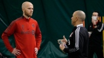 Michael Bradley, left, speaks to new head coach Chris Armas during a training session in Toronto on Wednesday, February 17, 2021 in this handout photo. THE CANADIAN PRESS/HO - Toronto FC