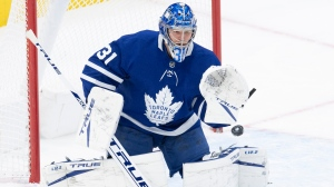 Toronto Maple Leafs goaltender Frederik Andersen (31) makes a save during second period NHL action against the Ottawa Senators in Toronto on Wednesday, February 17, 2021. THE CANADIAN PRESS/Frank Gunn
