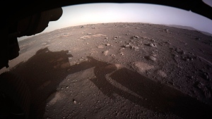 This photo provided by NASA shows the first color image sent by the Perseverance Mars rover after its landing on Thursday, Feb. 18, 2021. (NASA/JPL-Caltech via AP)