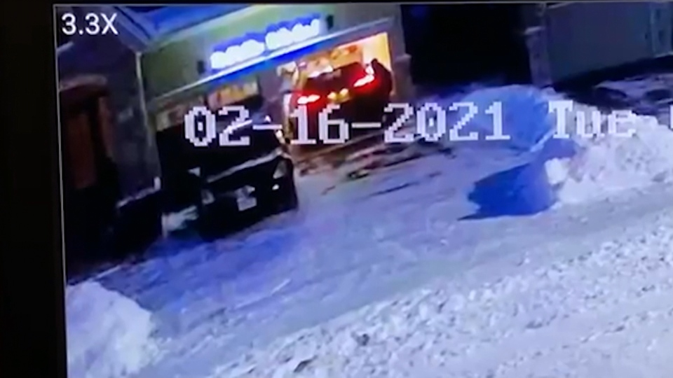 This image taken from surveillance camera footage appears to show an individual following a vehicle into a Georgetown home, where two people were later found dead. Their deaths are being investigated as suspicious.