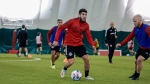 Alejandro Pozuelo dribbles the ball during a training session in Toronto on Wednesday, February 17, 2021 in this handout photo. THE CANADIAN PRESS/HO - Toronto FC