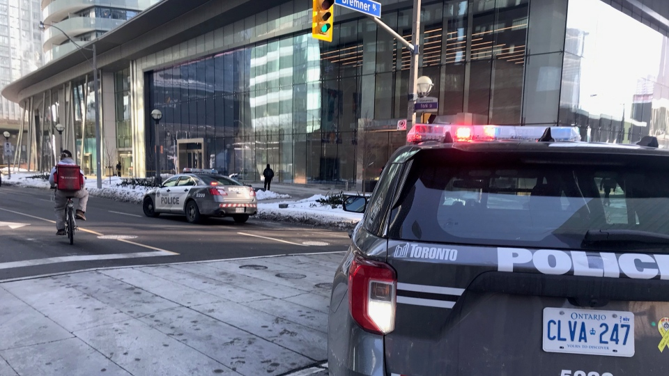 Police have closed downtown street after bottles were thrown from the balcony of a highrise. (CP24/Simon Sheehan)