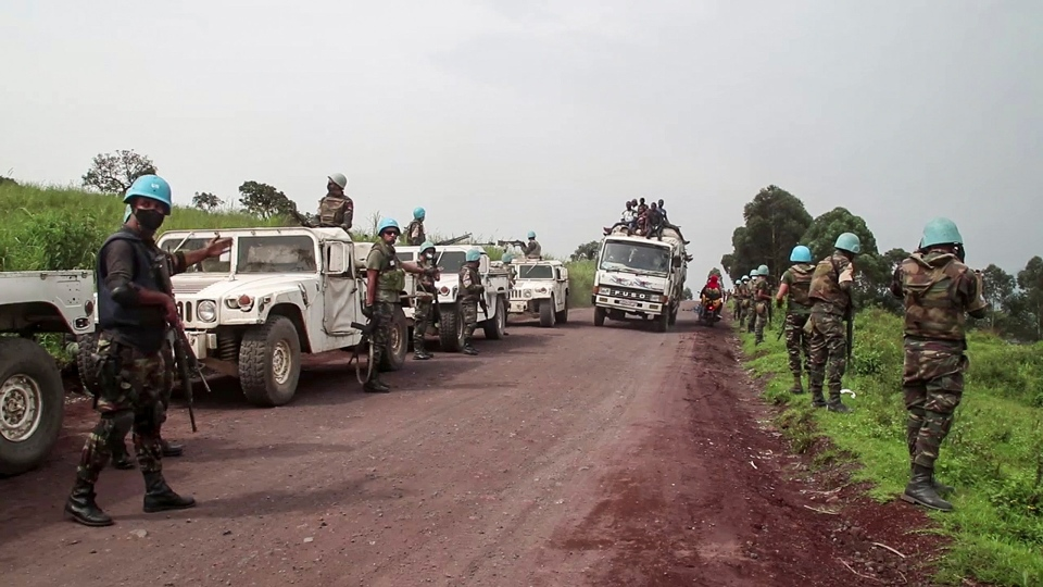 In this image from video, United Nations peacekeepers guard the area where a U.N. convoy was attacked and the Italian ambassador to Congo killed, in Nyiragongo, North Kivu province, Congo Monday, Feb. 22, 2021. The Italian ambassador to Congo Luca Attanasio, an Italian carabineri police officer and their Congolese driver were killed Monday in an attack on a U.N. convoy in an area that is home to myriad rebel groups, the Foreign Ministry and local people said. (AP Photo/Justin Kabumba)