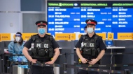Police and workers wait for arrivals at the COVID-19 testing centre in Terminal 3 at Pearson Airport in Toronto on Wednesday, February 3, 2021. THE CANADIAN PRESS/Frank Gunn