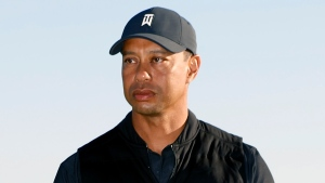 Tiger Woods looks on during the trophy ceremony on the practice green after the final round of the Genesis Invitational golf tournament at Riviera Country Club, Sunday, Feb. 21, 2021, in the Pacific Palisades area of Los Angeles. (AP Photo/Ryan Kang)
