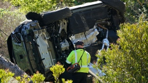 A vehicle rests on its side after a rollover accident involving golfer Tiger Woods Tuesday, Feb. 23, 2021, in Rancho Palos Verdes, Calif., a suburb of Los Angeles. (AP / Marcio Jose Sanchez)
