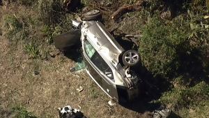 "In this aerial image take from video provided by KABC-TV video, a vehicle rest on its side after a rollover accident involving golfer Tiger Woods along a road in the Rancho Palos Verdes suburb of Los Angeles on Tuesday, Feb. 23, 2021. Woods had to be extricated from the vehicle with the ""jaws of life"" tools, the Los Angeles County Sheriff's Department said in a statement. Woods was taken to the hospital with unspecified injuries. The vehicle sustained major damage, the sheriff's department said. (KABC-TV via AP)"