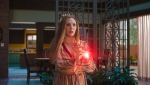 "This image provided by Marvel Studios shows Elizabeth Olsen as Wanda Maximoff in a scene from ""WandaVision."" (Marvel Studios via AP)"