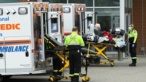 Paramedics transport an elderly man to the hospitals emergency department during the COVID-19 pandemic in Mississauga, Ont., on Thursday, November 19, 2020. Ontario has entered the second wave of coronavirus infections. THE CANADIAN PRESS/Nathan Denette