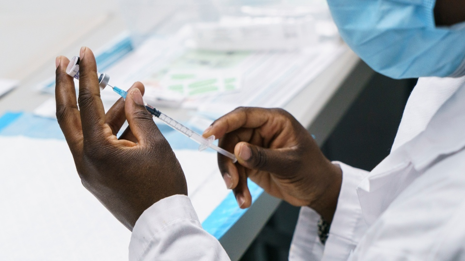 A dose of COVID-19 vaccine is prepared at a vaccination clinic in Montreal's Olympic Stadium on Tuesday, February 23, 2021. THE CANADIAN PRESS/Paul Chiasson