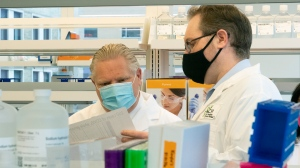 Ontario Premier Doug Ford and Ontario Institute for Cancer Research Genomics Director Trevor Pugh discuss COVID-19 research in Toronto on Tuesday, February 23, 2021. THE CANADIAN PRESS/Frank Gunn