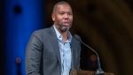 "FILE - Author Ta-Nehisi Coates speaks during the Celebration of the Life of Toni Morrison in New York on Nov. 21, 2019. Coates, the acclaimed essayist and novelist who expanded the world of Wakanda in Marvel comics, will write the script for a new ""Superman"" film from Warner Bros. The studio announced Friday that Coates will pen the screenplay for an upcoming ""Superman"" film that's early in development. (AP Photo/Mary Altaffer, File)"