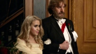 """This image released by Amazon Studios shows Maria Bakalova, left, and Sacha Baron Cohen in a scene from """"Borat Subsequent Moviefilm."""" (Amazon Studios via AP)"""