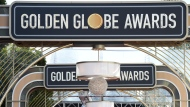FILE - Event signage appears above the red carpet at the 77th annual Golden Globe Awards, on Jan. 5, 2020, in Beverly Hills, Calif. The 78th annual Golden Globes will be held on Sunday, Feb. 18, 2021. (Photo by Jordan Strauss/Invision/AP, File)