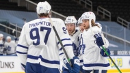 Toronto Maple Leafs' William Nylander, right, celebrates his goal against the Edmonton Oilers with teammates Joe Thornton, left to right, Morgan Rielly and Mitchell Marner during first period NHL action in Edmonton on Saturday, February 27, 2021. THE CANADIAN PRESS/Jason Franson