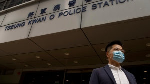 Former legislator and District Council member Gary Fan who was arrested under Hong Kong's national security law poses for photographers before walking in a police station in Hong Kong Sunday, Feb. 28, 2021. Across Hong Kong, dozens of others including former lawmakers and democracy advocates who were arrested in connection with Hong Kong's new National Security Law, went back into a police station Sunday, following a surprise request from police Friday. (AP Photo/Vincent Yu)