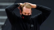 Toronto Raptors head coach Nick Nurse reacts to a foul ball during the second half of an NBA basketball game against the Miami Heat Friday, Jan. 22, 2021, in Tampa, Fla. (AP Photo/Chris O'Meara)