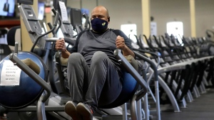 Earl Edwards, of Canton, Mass., works out on  Monday, July 6, 2020, at Answer is Fitness gym, in Canton. THE CANADIAN PRESS/AP, Steven Senne