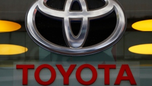 In this Sept. 20, 2017, file photo the Toyota logo is displayed at their shop on the Champs Elysees Avenue in Paris. The U.S. government is investigating complaints of engine compartment fires in nearly 1.9 million Toyota RAV4 small SUVs. The National Highway Traffic Safety Administration began investigating after getting 11 fire complaints involving the 2013 through 2018 model years.   (AP Photo/Francois Mori, File)