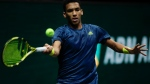 Canada's Felix Auger-Aliassime plays a shot against Japan's Kei Nishikori during their first round men's singles match of the ABN AMRO world tennis tournament at Ahoy Arena in Rotterdam, Netherlands, Monday, March 1, 2021. Norrie won in two sets, 6-0, 6-3. (AP Photo/Peter Dejong)