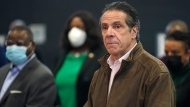 In this Feb. 22, 2021 photo, New York Gov. Andrew Cuomo, right, pauses to listen to a reporter's question during a news conference at a COVID-19 vaccination site in the Brooklyn borough of New York. (AP Photo/Seth Wenig, Pool, file)