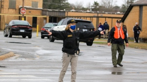 Sheriffs department personnel work Monday March 1, 2021 in Pine Bluff, Ark. directing traffic around the Watson Chapel Junior High School after a shooting at the school. (Staton Breidenthal/The Arkansas Democrat-Gazette via AP)