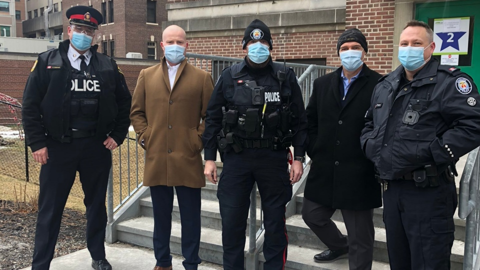 A number of police officers are shown at Michael Garron Hospital on Monday a the vaccination of some frontline cops got underway. (Twitter/Brian Callanan)