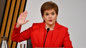 First Minister of Scotland Nicola Sturgeon takes the oath before giving evidence to the Committee on the Scottish Government Handling of Harassment Complaints, at Holyrood in Edinburgh, Scotland, Wednesday March 3, 2021. The inquiry is investigating the government's handling of sexual harassment allegations against former leader Alex Salmond, and allegations that Sturgeon misled parliament. (Jeff J Mitchell/PA via AP)