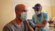 A patient receives an injection of the 'Covishield'' coronavirus vaccine manufactured by the Serum Institute of India from a nurse at a hospital in the capital Victoria, Mahe Island, Seychelles Wednesday, Feb. 24, 2021. The president of the Indian Ocean island nation of Seychelles says he hopes enough residents will soon be vaccinated against COVID-19 to stop the spread of the virus, hoping to achieve herd immunity by mid-March by vaccinating about 70% of the population. (AP Photo)