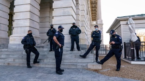 "Heightened security remains around the U.S. Capitol since the Jan. 6 attacks by a mob of supporters of then-President Donald Trump, in Washington, Wednesday, March 3, 2021. The U.S. Capitol Police say they have intelligence showing there is a ""possible plot"" by a militia group to breach the U.S. Capitol on Thursday. (AP Photo/J. Scott Applewhite)"