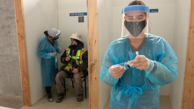 Nurses administer rapid COVID-19 tests at a construction site in Toronto on Thursday, February 18, 2021. THE CANADIAN PRESS/Frank Gunn