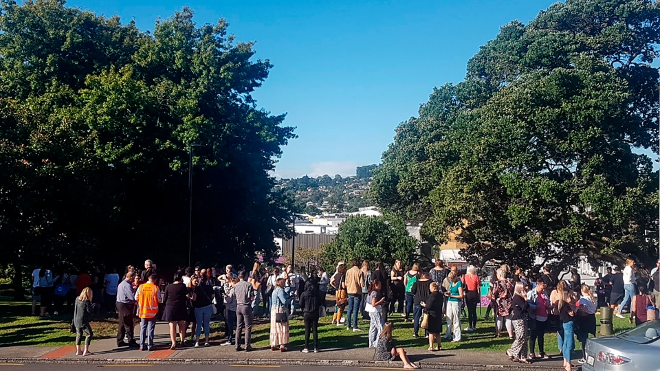 People gather on high ground in Whangarei, New Zealand, as a tsunami warning is issued Friday, March 5, 2021. A powerful magnitude 8.1 earthquake struck in the ocean off the coast of New Zealand prompting thousands of people to evacuate and triggering tsunami warnings across the South Pacific. (Mike Dinsdale/New Zealand Herald via AP)