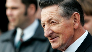 Walter Gretzky talks to people while at the funeral of Celtic music legend John Allan Cameron at St. Isaac Jogues Church in Pickering, Ont., Monday, Nov. 27, 2006. Walter Gretzky, the ultimate Canadian hockey dad who taught and nurtured the Great One, has died. He was 82. THE CANADIAN PRESS/Nathan Denette