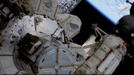 This photo provided by NASA shows US astronaut Kate Rubins outside the International Space Station during a space walk on Friday, March 5, 2021. Rubins and Japan's Soichi Noguchi floated outside to complete unfinished work from Sunday's spacewalk. More mounting brackets and struts need to be installed for new and improved solar panels due to arrive in June. (NASA via AP)