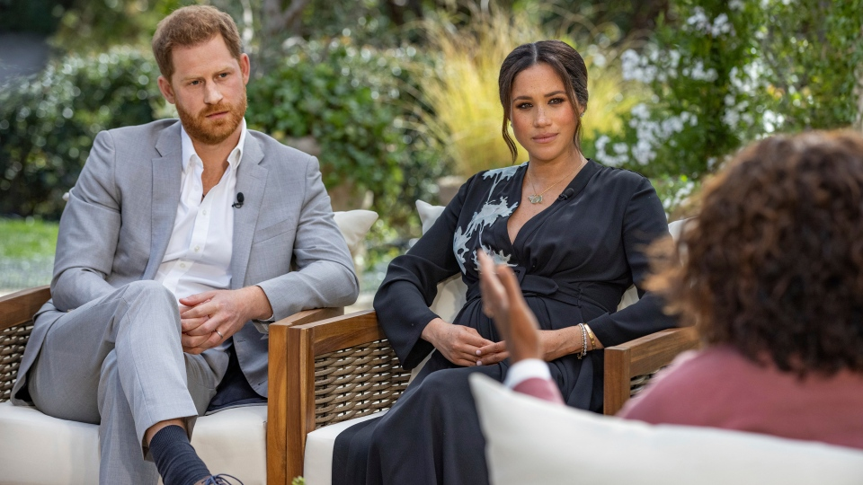 "This image provided by Harpo Productions shows Prince Harry, from left, and Meghan, Duchess of Sussex, in conversation with Oprah Winfrey. ""Oprah with Meghan and Harry: A CBS Primetime Special"" airs March 7. (Joe Pugliese/Harpo Productions via AP)"