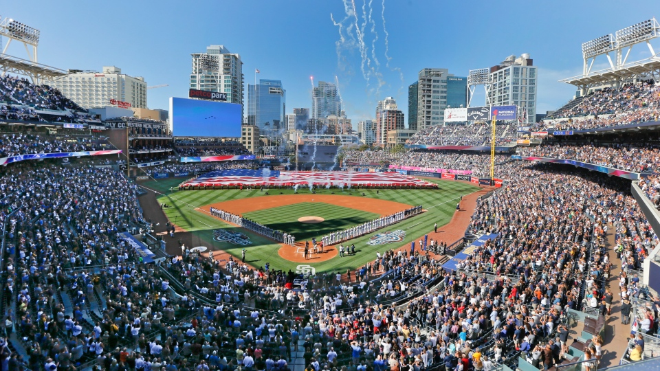 FILE - In this April 4, 2016, file photo, opening day ceremonies are performed at Petco Park before a baseball game between the Los Angeles Dodgers and the San Diego Padres in San Diego. California officials will allow people to attend Major League Baseball games and other sporting events, go to Disneyland and watch live performances in limited capacities starting April 1, 2021. The rules announced Friday, March 5, 2021, coincide with baseball's opening day. (AP Photo/Lenny Ignelzi, File)