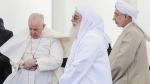 Pope Francis, left, attends an interreligious meeting near the archaeological area of the Sumerian city-state of Ur, 20 kilometers south-west of Nasiriyah, Iraq, Saturday, March 6, 2021. Ur is considered the traditional birthplace of Abraham, the prophet common to Muslims, Christians and Jews.Francis traveled to the southern ruins of Ur on Saturday to reinforce his message of interreligious tolerance and fraternity during the first-ever papal visit to Iraq, a country riven by religious and ethnic divisions. (AP Photo/Andrew Medichini)