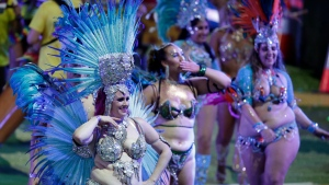 Participants march in the Gay and Lesbian Mardi Gras parade at the Sydney Cricket Ground in Sydney, Saturday, March 6, 2021. The annual event has been forced into a sport stadium due to COVID-19 restrictions. (AP Photo/Rick Rycroft)