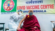 This photograph provided by Office of his Holiness the Dalai Lama shows the Tibetan spiritual leader receiving a shot of the COVID-19 vaccine at Zonal Hospital in Dharmsala, India, Saturday, March 6, 2021. (Office of the his holiness the Dalai Lama via AP)