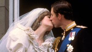 FILE - In this July 29, 1981 file photo, Britain's Prince Charles kisses his bride, the former Diana Spencer, on the balcony of Buckingham Palace in London, after their wedding. Britain's royal family and television have a complicated relationship. The medium has helped define the modern monarchy: The 1953 coronation of Queen Elizabeth II was Britain's first mass TV spectacle. Since then, rare interviews have given a glimpse behind palace curtains at the all-too-human family within. (AP Photo/File)