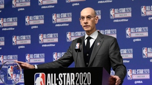 FILE - In this Feb. 15, 2020, file photo, NBA Commissioner Adam Silver unveils the NBA All-Star Game Kobe Bryant MVP Award during a news conference in Chicago. Silver was discussing the league's ongoing pandemic response and plans for next season on Saturday in his annual address at the All-Star Game. This year's game is Sunday in Atlanta. (AP Photo/David Banks)